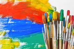 油漆和画笔 免版税库存照片