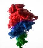 油漆在水,红色五颜六色中 免版税库存图片