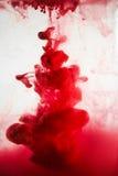 油漆在水,红色,五颜六色,蓝色,绿色,黄色中 免版税图库摄影