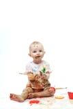 油漆弄脏的婴孩 库存照片