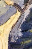 油漆抽象背景在帆布的 库存照片