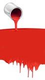油漆能在白色的倾吐的滴下的红色 库存图片