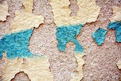 油漆,街道画,在老古色古香的威尼斯式墙壁上的蓝灰色颜色 免版税图库摄影