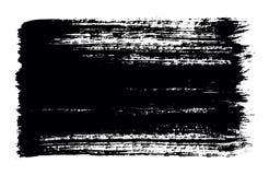 油漆黑刷子冲程在白色背景的 免版税库存图片