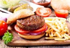 油煎汉堡包蔬菜 库存照片