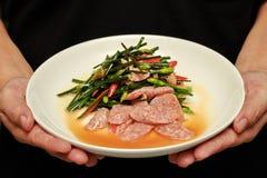 油煎的中国香葱用泰国酸香肠 免版税库存照片