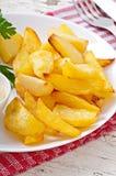 油煎的土豆楔子 免版税库存图片