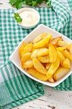 油煎的土豆楔子 图库摄影