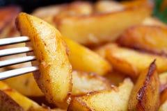 油煎的土豆特写镜头 免版税库存图片