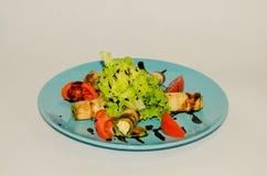 油煎的夏南瓜用乳酪和菜 免版税图库摄影