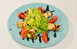油煎的夏南瓜用乳酪和菜 库存图片