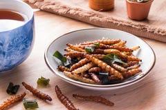 油煎的昆虫-竹蠕虫昆虫酥脆与pandan在frie以后 免版税库存照片