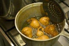 油煎的油炸圈饼 免版税库存图片