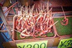 油煎的章鱼触手,宫岛日本 免版税库存图片