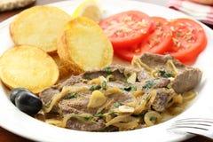 油煎的肝脏猪肉-葡萄牙传统食物 图库摄影