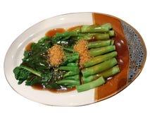 油煎的菜和牡蛎调味汁 库存照片