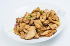 油煎的蘑菇用黄油 免版税库存照片