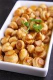 油煎的蘑菇(蘑菇)用卤汁 免版税库存图片
