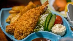 油煎的虾和调味汁 图库摄影