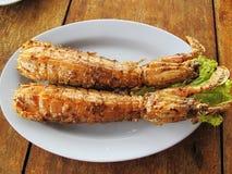 油煎的虾蛄用大蒜和胡椒 库存图片
