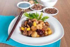 油煎的被分类的五种类中国坚果 库存图片
