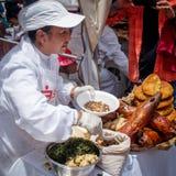 油煎的试验品(Cuy)在市场上在秘鲁 免版税库存照片