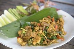 油煎的辣公猪泰国食物,与公猪的混乱炒饭 免版税库存照片