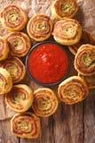 油煎的辣土豆卷和西红柿酱特写镜头 垂直的上面 库存图片