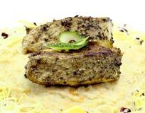 油煎的鱼用纯的土豆 免版税库存照片