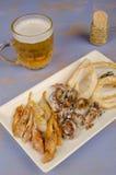 油煎的鱼,西班牙塔帕纤维布 免版税库存照片