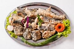 油煎的鲱鱼盘 免版税库存图片