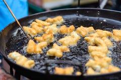 油煎的麦子面团 免版税库存图片