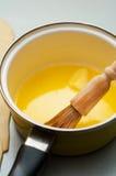 黄油熔化了 库存照片