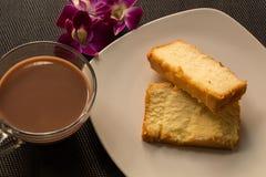 黄油蛋糕&热巧克力 库存照片