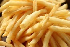油腻的炸薯条特写镜头,不健康的食物 库存图片