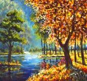 油画秋天金树和绿色杉树在岸反对蓝色山河背景  库存照片
