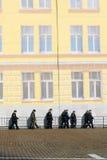 沿人为墙壁的战士步行 库存图片