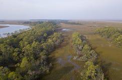 沿海盐沼和森林鸟瞰图  免版税库存图片