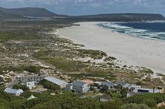 沿街叫卖者的高峰驱动。Noordhoek海滩。 免版税库存图片