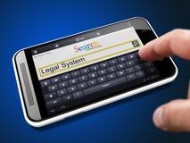 法制系统-在智能手机的搜索字符串 库存照片