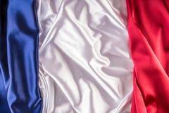 法国国旗由三五颜六色的缎织品制成 库存照片