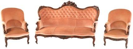 法国木桃红色沙发和两把扶手椅子 库存照片