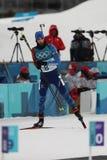 法国的奥林匹克冠军马丁Fourcade在两项竞赛人` s 12竞争 在2018个冬季奥运会的5km追求 免版税库存图片