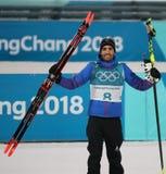 法国的奥林匹克冠军马丁Fourcade在两项竞赛人` s 12竞争 在2018个冬季奥运会的5km追求 免版税图库摄影