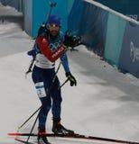 法国的奥林匹克冠军马丁Fourcade庆祝在两项竞赛人` s 15km许多开始的胜利在2018个冬季奥运会 图库摄影