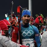 法国的奥林匹克冠军马丁Fourcade庆祝在两项竞赛人` s 15km许多开始的胜利在2018个冬季奥运会 免版税图库摄影