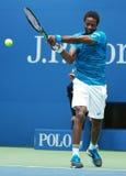 法国的职业网球球员Gael Monfis行动的在他的美国公开赛2016年四分之一决赛比赛期间 免版税库存照片