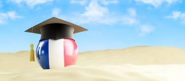 法国语言在度假,在海滩的毕业盖帽 库存照片