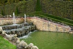 法国,三个喷泉树丛在凡尔赛宫公园 免版税图库摄影