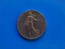 1法郎硬币,在蓝色的法国 库存图片